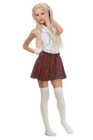 short skirt: Lovely sexy blonde girl in checkered short skirt with big blue headphones, isolated on white
