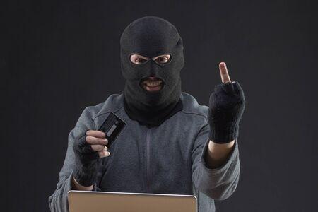stolen: Hacker hold stolen credit card in hand