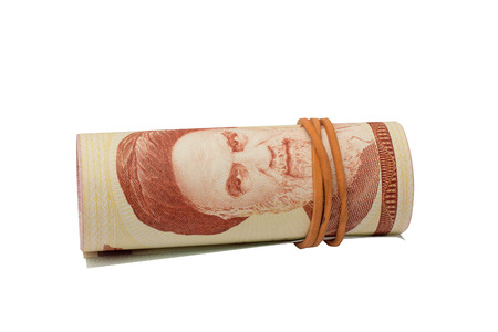 rubber ring: Rolled rial banknotes with a rubber ring, isolated
