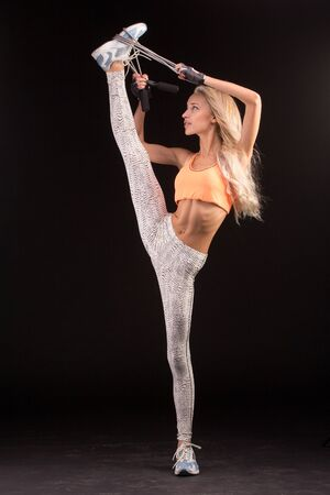 skipping rope: Vertical splits with skipping rope. Caucasian dancer girls, isolated