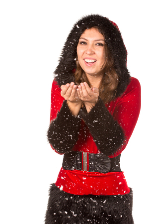 christmas costume: Beautiful young woman dressed with Christmas costume, blowing to snow, isolated over white