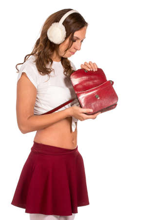 pocket book: Beautiful woman looking through her pocket book purse, isolated Stock Photo