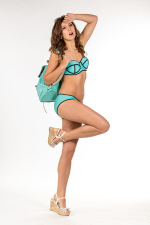 social emotional: Pretty woman in swimsuits hold a blue backpack.
