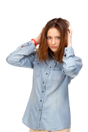 girl posing: Beauty red girl in jeans shirt, isolated on white Stock Photo
