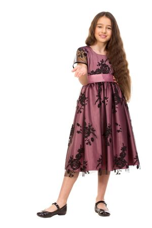 six years: Long haired girl of six years in a summer dress isolated on white background.
