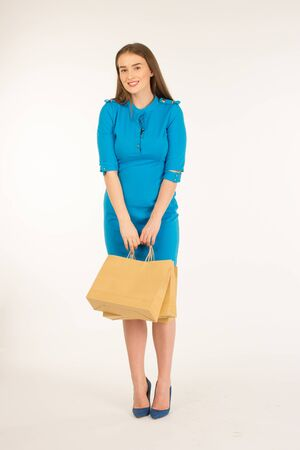 frendly: Pretty woman in blue dress posing with eco frendly paper bags