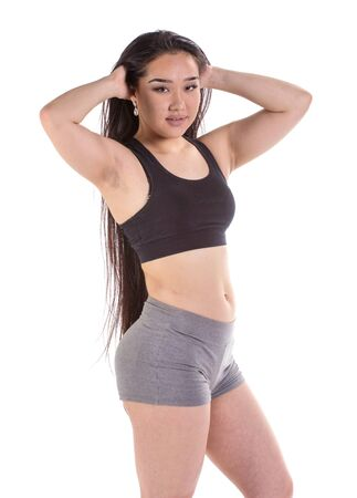 regimen: Beautiful fitness oriental woman standing - isolated over a white background