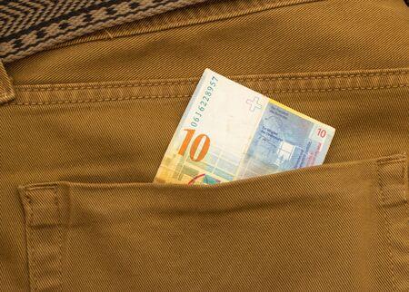 Swiss Franc Banknote in back pocket of blue jeans