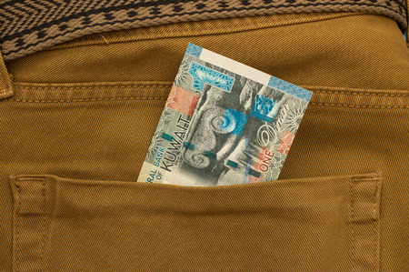 arabic currency: Kuwait Banknote in back pocket of blue jeanse Stock Photo