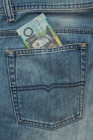 banknote: 10 Australian dollar Banknote in back pocket of blue jeans