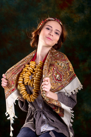 baranka: Portrait of young woman in Rissian dress, national scarf on black backgeround