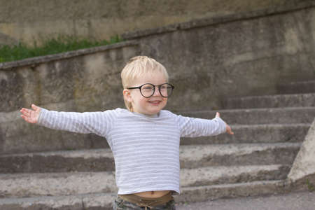 falling down: Happy child with falling down glasses, outdoors