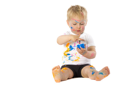 5 years old: 5 years old boy playing with paint, isolated on white