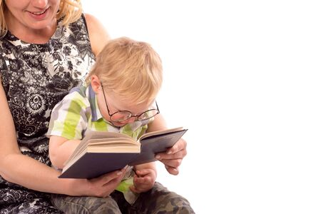 child sitting: Cute happy kid potter style, reading a book Stock Photo