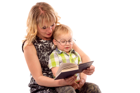 Cute happy kid potter style, reading a book Stock Photo