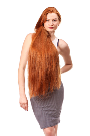 red hair beauty: Beauty Girl Portrait. Healthy Long Red Hair. Beautiful Young Woman isolated on a white background