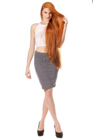 long red hair: Beauty Girl Portrait. Healthy Long Red Hair. Beautiful Young Woman isolated on a white background