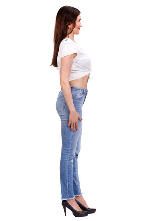 snaps: Pretty woman snaps in jeans isolated on white