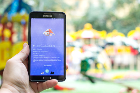 gameplay: AUG 03, 2016 MOSCOW, RUSSIA: Pokemon Go gameplay screenshot on the phone. Goldeen  pokemon on mobile phone screen. Pokemon Go is a modern location-based augmented reality mobile game.