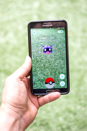 screenshot: AUG 03, 2016 MOSCOW, RUSSIA: Pokemon Go gameplay screenshot on the phone. Shellder pokemon on mobile phone screen. Pokemon Go is a modern location-based augmented reality mobile game. Editorial