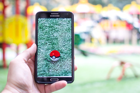 gameplay: AUG 03, 2016 MOSCOW, RUSSIA: Pokemon Go gameplay screenshot on the phone. Pokebol on mobile phone screen. Pokemon Go is a modern location-based augmented reality mobile game.