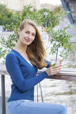 Beautiful Woman with mojito cocktail. Summer. Outdoor portrait