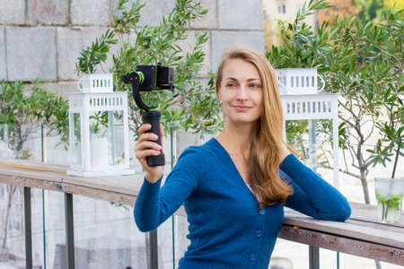 mohito: Pretty fashion blogger making stream report with mohito outdoors