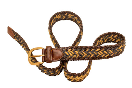 Leather braided belt for men on white background. Selective focus.