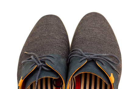 shoestrings: Part of pair blue man shoe with shoelace from above. Isolated on white. Stock Photo