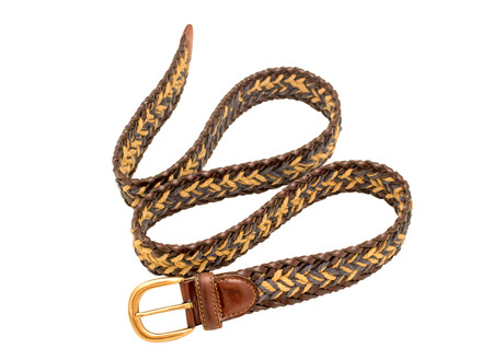 suede belt: Leather braided belt for men on white background. Selective focus.