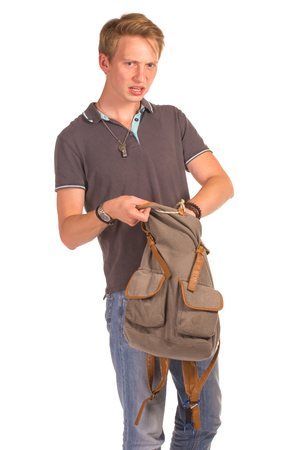 only one teenage boy: Young shocked student opening his backpack and looking for something in it. Isolated on white background