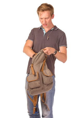 only one teenage boy: Young shocked student opening his backpack. Isolated on white background