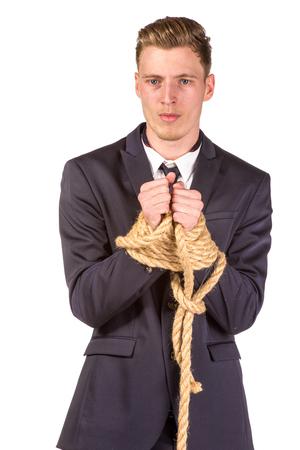 Geschäftsmann im Seil gefesselt. Isoliert auf weiß Standard-Bild