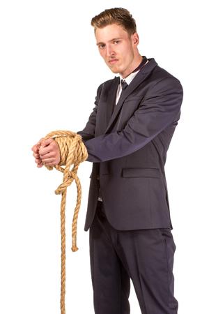 Geschäftsmann im Seil gefesselt. Isoliert auf weiss