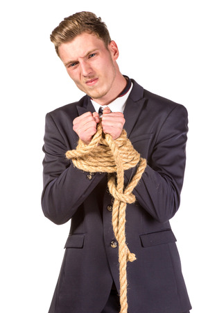 tied in: Businessman tied up in rope. Isolated on white Stock Photo