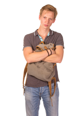 only one teenage boy: Portrait of happy smiling student with backpack in front of him, isolated on white background
