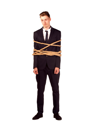 slavery: Full-length portrait of businessman tied with the rope, isolated on white. Concept of slavery and violence Stock Photo