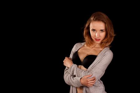 Portrait of pretty women in studio in underwear on black background. Stock fotó