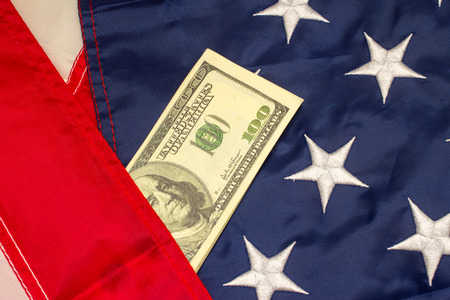 united stated: American dollars on the flag of United Stated of America.