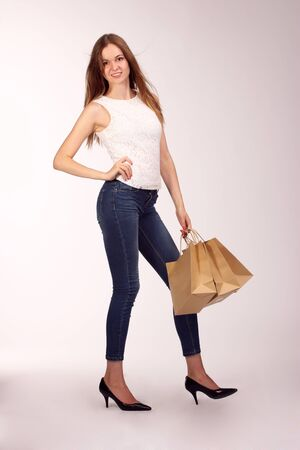 biodegradable: Picture of lovely woman with biodegradable shopping bag.