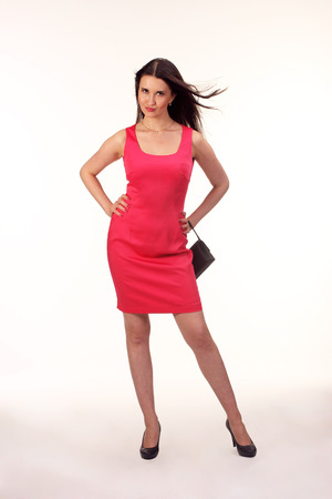 clutches: Picture of lovely brunette woman in red dress with small bag.