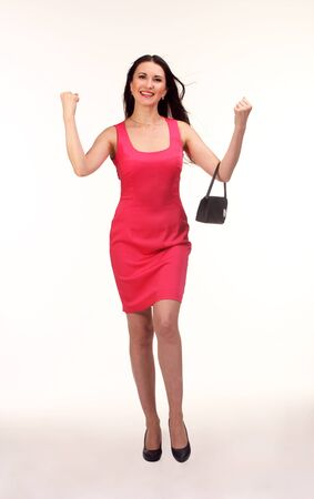 Picture of lovely brunette woman in red dress with small bag.