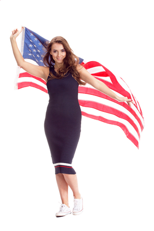 Happy young woman holding USA flag. Image isolated on a white background