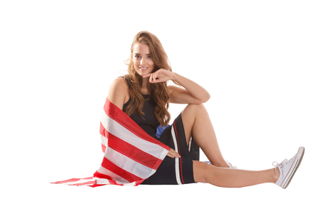 Happy patriotic woman holding USA flag. Image isolated on a white background