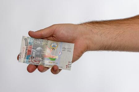 Kuwaiti dinar banknote in hand. Kuwaiti dinar is the national currency of Kuwait Stock Photo