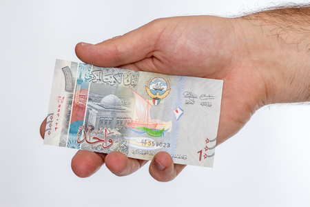 arabic currency: Kuwaiti dinar banknote in hand. Kuwaiti dinar is the national currency of Kuwait Stock Photo