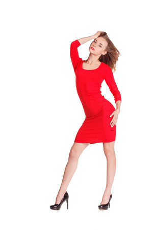 Woman in red posing against white background.