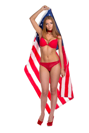 Flag of United States of America in hands of beautiful woman. Isolated on white.