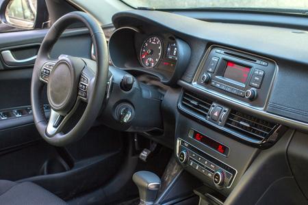 inwards: Dark luxury car Interior - steering wheel, shift lever and dashboard
