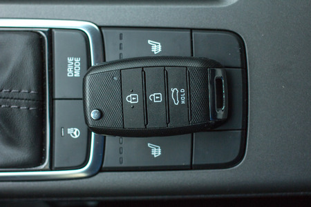 key fob: Modern Car remote control key in vehicle interior